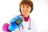Doctor checking diabetic's blood sugar — Stok fotoğraf