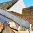Ancient roof made with tiles - Stock Photo