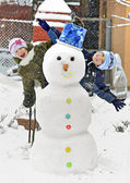 Snowman and kids — Stock Photo