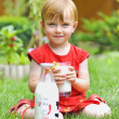 Girl and glass of milk — Stock Photo
