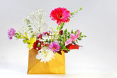 Envelope and flowers — Stock Photo