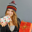 Stock Photo: Winter girl with gift