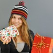 Winter girl with gift — Stock Photo