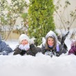 Stock Photo: Children Laying On snow