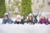 Children Laying On snow — Stock Photo