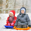 Kids sit on sled — Stock Photo