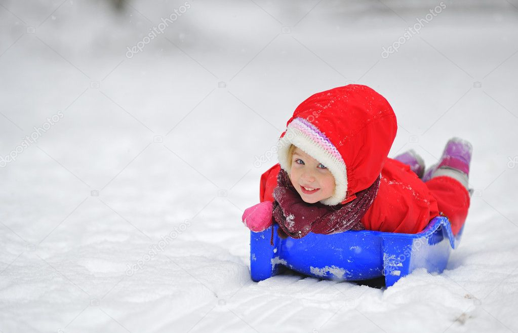 Girl on sleigh   Stock Photo #4589213