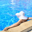 Woman in a pool relaxing - Stock Photo