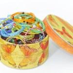 Many colorful fashion bracelets in box — Stock Photo #4776634