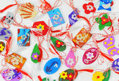 Female ornaments from polymeric hand-worked clay — Stock Photo