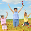 Family on poppy field — Stock Photo #4853862