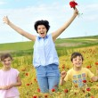 Family on poppy field — Stock Photo