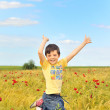 Happy boy jumping on field — Stock Photo #4853866