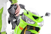 Motorcycle gloves with carbon and bike — Stock Photo