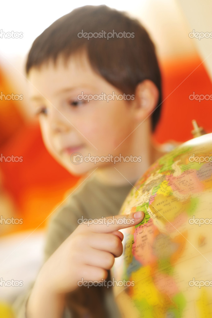 Boys finger pointing on world globe   Stock Photo #4881919