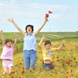 Family on poppy field — Stock Photo #5332735