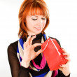 Stock Photo: Young woman with red bag present
