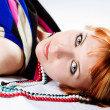 Red-haired coquettish young woman lies — Stock Photo