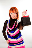 Portrait young woman carrying shopping bags — Stock Photo