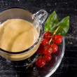 Espresso cofee with currants on black glass table — Stock Photo #4897806