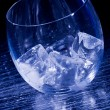 Glass with ice cubes — Stock Photo
