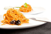 Spaghetti with olives and tomatoe sause - Pasta alla Puttanesca — Stock Photo