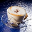 Royalty-Free Stock Photo: Cappuccino on blue glass table