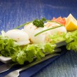 Squid with lettuce on blue glasstable - Stock Photo