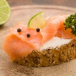 Slice of Bread with creme fraiche and smoked salmon — Stok fotoğraf