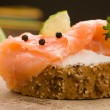 Slice of Bread with creme fraiche and smoked salmon — Stock Photo #5037126