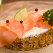 Slice of Bread with creme fraiche and smoked salmon — Stock Photo