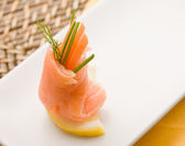 Smoked Salmon rolls with tomatoes — Stock Photo