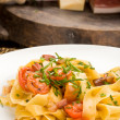 Pasta with bacon and tomatoes - Zdjęcie stockowe