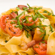 Pasta with bacon and tomatoes - Foto Stock
