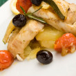 Stock Photo: Baked Cod with olives and tomatoes
