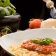 Pasta with tomatoe sauce and ingredients — Stock Photo