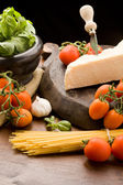 Ingredients for pasta with tomatoe sauce — Stock Photo