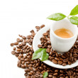 Stock Photo: Espresso with green leaves on white background