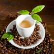 Espresso with green leaves — Stock Photo