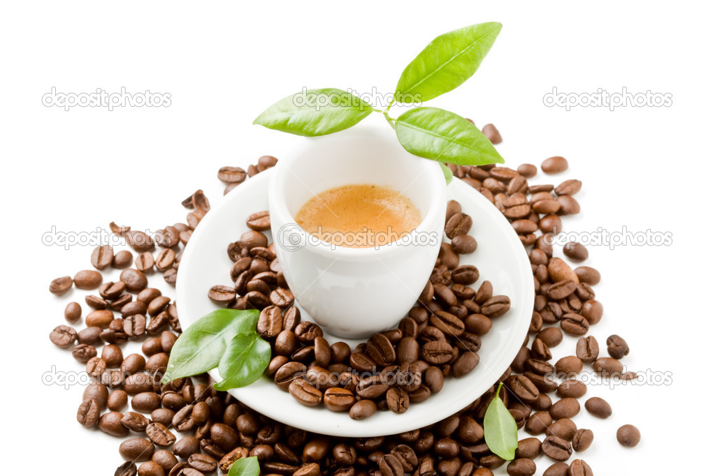 Photo of espresso cup over coffee beans with green leaves on white isolated background — Stock Photo #5286290