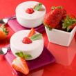 Strawberry yogurt with mint leaf — Stock Photo