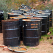 Human Waste Barrels - Stock Photo