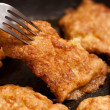 Chicken chops on griddle - Foto Stock