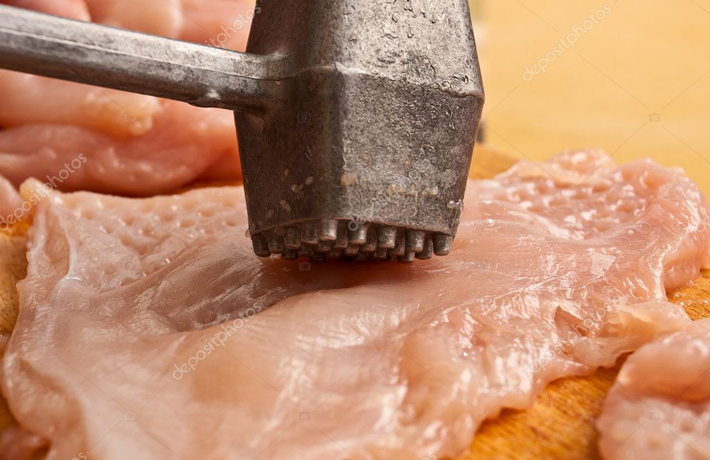 Prepearing chicken meat with hammer  Stock Photo #5360754