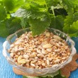 Seeds in  bowl with herbs — Stock Photo
