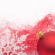 Red Christmas bauble and snowflake — Stock Photo #4133816