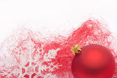 Red Christmas bauble and snowflake — Stock fotografie