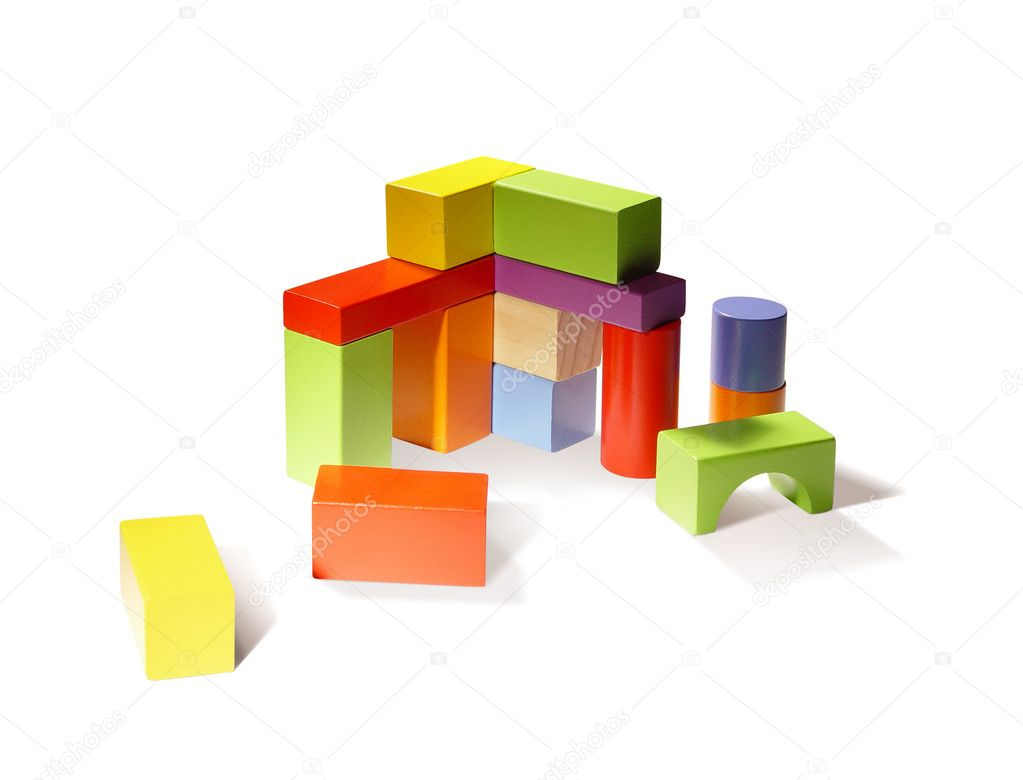 Building from wooden colourful childrens blocks. — Stock Photo #4272541
