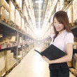 Asian girl in warehouse — Stock Photo