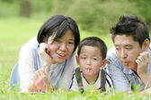 Outdoor asian family portrait with — Stock Photo